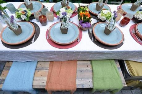 Table settings included planters and terracotta bases that evoked the theme
